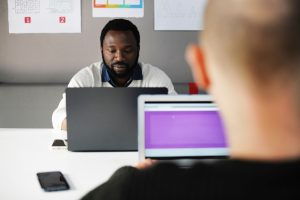 Men on laptops for eDiscovery security